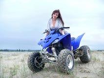 Beautiful girl on a quad bike. Stock Photo