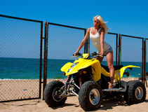 Beautiful girl on a quad Royalty Free Stock Photos