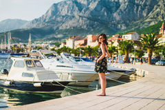 Beautiful girl at quay Stock Photo