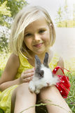 Beautiful girl with a rabbit Royalty Free Stock Images