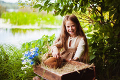 Beautiful girl with a rabbit in the woods Stock Photos