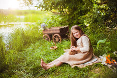 Beautiful girl with a rabbit in the woods Royalty Free Stock Photo