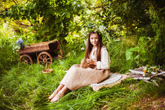 Beautiful girl with a rabbit in the woods Royalty Free Stock Images