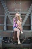 The beautiful girl and railway wagon Royalty Free Stock Image