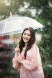 Beautiful girl in the rain with transparent umbrella Stock Photos