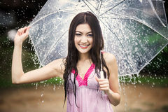 Beautiful girl in the rain with transparent umbrella Stock Photography