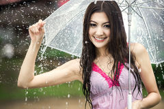 Beautiful girl in the rain with transparent umbrella Royalty Free Stock Photography