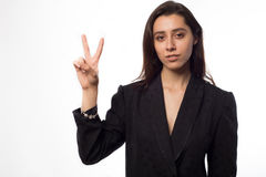 Beautiful girl raising two fingers up on hand it is shows peace strength fight or victory symbo royalty free stock photography