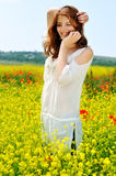 Beautiful girl on rapeseed field Stock Image