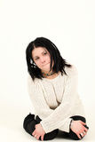 Beautiful girl with rasta style is sitting Royalty Free Stock Photo