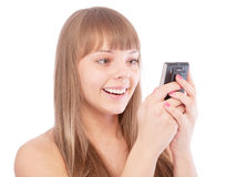 Beautiful girl read sms by phone and laughs Stock Photos