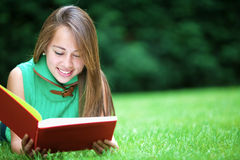 Beautiful girl reading Royalty Free Stock Images