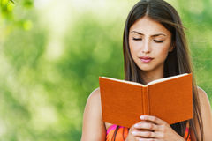 Beautiful girl reading book Royalty Free Stock Photos