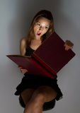 Beautiful girl reading a book. Stock Images