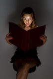 Beautiful girl reading a book. Royalty Free Stock Images