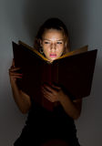 Beautiful girl reading a book. Royalty Free Stock Image