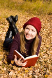 Beautiful girl reading a book Stock Photography