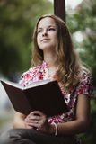 Beautiful girl reading book Stock Images