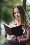 Beautiful girl reading book Royalty Free Stock Photos