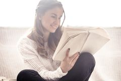 Girl reading a book closeup on the sofa Royalty Free Stock Photo