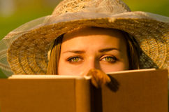 Beautiful girl reading book in the nature Royalty Free Stock Image