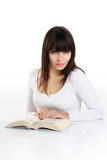 Beautiful girl reading a book on white Royalty Free Stock Image