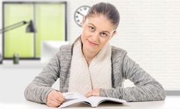 Beautiful girl reading a book on white background Stock Photos