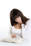 Beautiful girl reading a book on white Stock Images