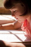 Beautiful Girl Reading Holy Bible Royalty Free Stock Photos