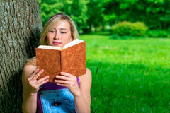 Beautiful girl reading an interesting book Royalty Free Stock Image