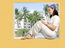 Beautiful girl reading in a tropical resort Royalty Free Stock Photo