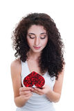 Beautiful girl reading valentine's card Royalty Free Stock Photography