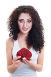 Beautiful girl reading valentine's card Stock Photo