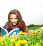 Beautiful girl  reads the boo Stock Photo