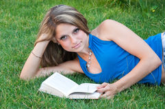 Beautiful girl reads the book Stock Photos
