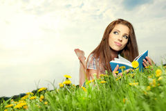 Beautiful girl  reads the book Royalty Free Stock Photo