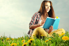 Beautiful girl  reads the book Stock Photo