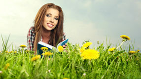 Beautiful girl  reads the book Stock Images