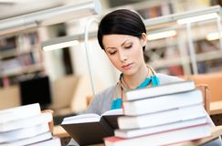 Beautiful girl reads at the library Stock Image