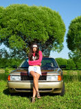 Beautiful girl ready for washing a retro car Stock Images