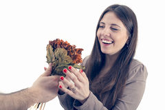 Beautiful girl receives a bouquet from her boyfriend isolated Royalty Free Stock Photo
