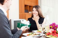 Beautiful girl receives a gift from a guy Royalty Free Stock Image