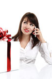 Beautiful girl receives a surprise gift box with red ribbon Stock Photo
