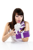 Beautiful girl receives a surprise gift Stock Photo