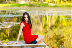 Beautiful girl in red Stock Images