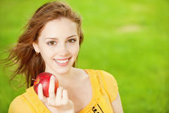 Beautiful girl with red apple Royalty Free Stock Photos