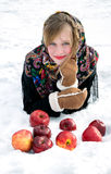 Beautiful girl with red apples on snow Stock Image