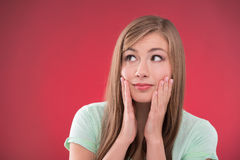Beautiful girl on red background Royalty Free Stock Photo