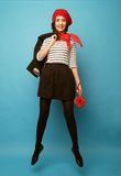 Beautiful girl in a red beret. French style. Royalty Free Stock Photos