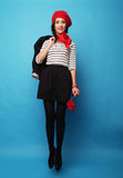 Beautiful girl in a red beret. French style. Stock Photos